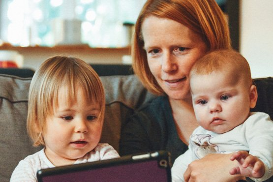Mom and kids look at tablet