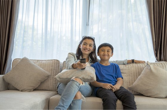 Mom and son with remote